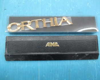 AMC - Ortia (EL2) rear gold emblem